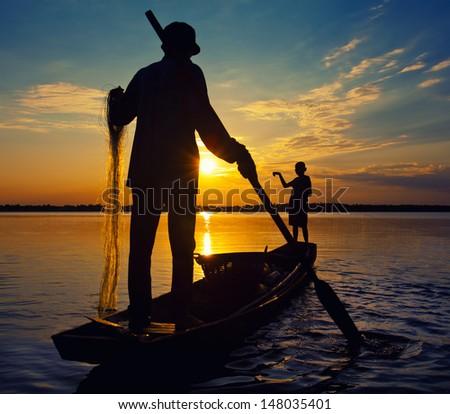 Fisherman Thailand sunset  Asia - stock photo