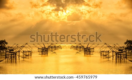 Fisherman tool with sunrise,with orange sky, Pakpra, Phatthalung,Thailand  - stock photo
