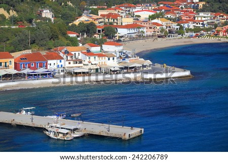 Fisherman town with narrow pier extended on the Ioanian sea , Greece - stock photo