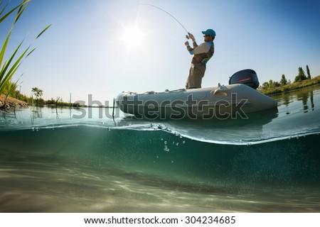 Fisherman, underwater view  - stock photo