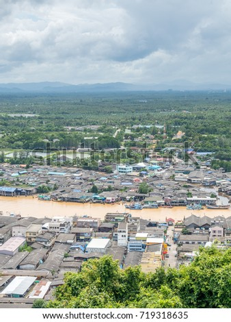 Fisherman village at estuary of river in Chumphon under cloudy sky in Thailand