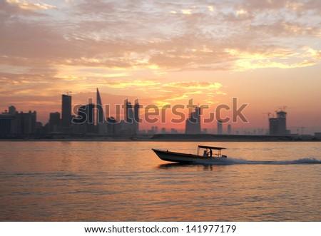Fisherman way back home during sunset - stock photo