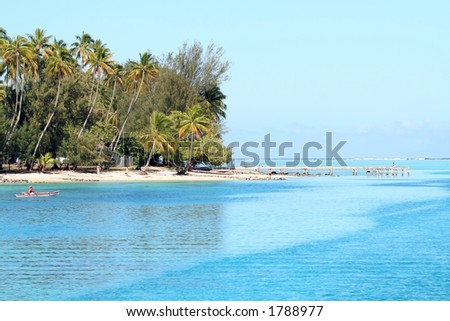 Fisherman with a wooden paddle boat, tropical beach, tahiti - stock photo