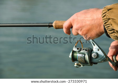 Fisherman with spinning on the river