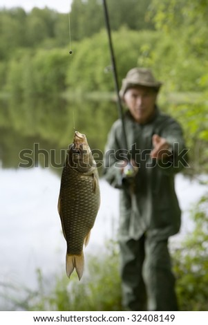 Fisherman with trophy carp. This carp was released moments after photo was taken. - stock photo