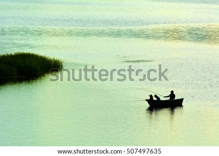 fishermen and colored lake