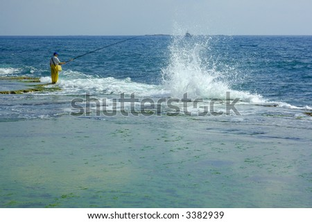 Fishermen and surf, Mediterranean sea