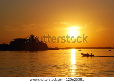 fishermen at sunset - stock photo