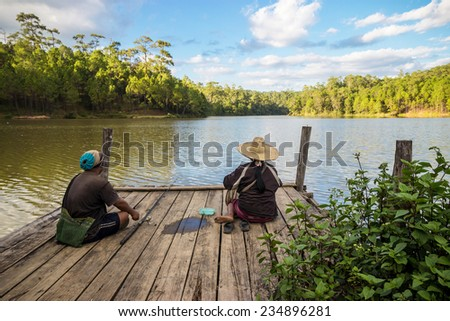 Fishermen at the dock in Thailand - stock photo