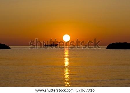 Fishermen boat at sunshine in the mediterranean. - stock photo