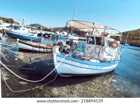 Fishermen boats at Kalamitsi harbor in Sithonia, Northern Greece, toned image - stock photo