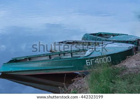 fishermen boats at landing place. - stock photo
