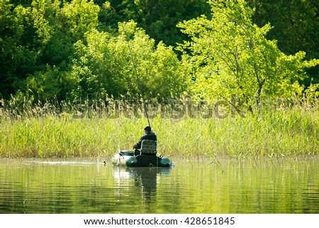 fishermen catch fish with a rubber boat