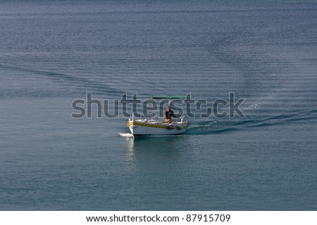 Fishermen coming back to the port on the blue sea