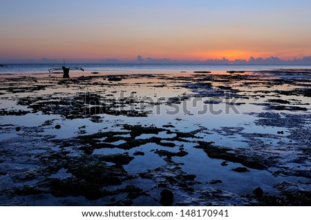 Fishermen Dhow Boat  at sunset from  in the sea. - stock photo