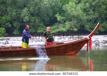 Fishermen find fish at phang nga bay. Thailand - stock photo