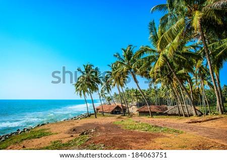 Fishermen hut in the tropical village near the blue ocean in Varkala, Kerala, India - stock photo