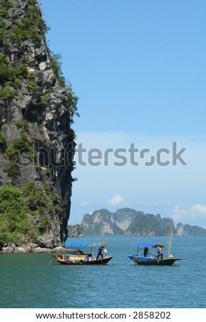 Fishermen In Ha Long Bay - stock photo