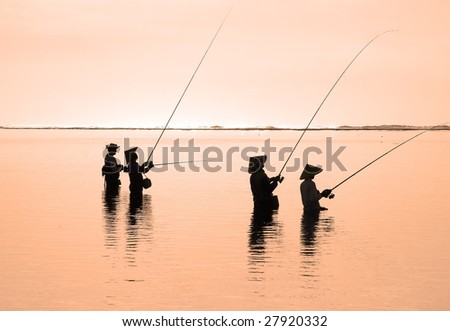 Fishermen in the morning sun, ocean coast, Bali, Indonesia (2)