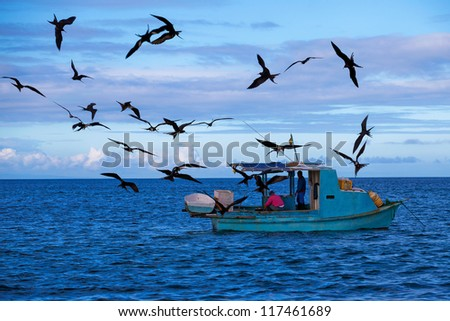 Fishermen in the Pacific - stock photo