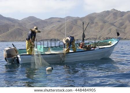 Fishermen pulling net in Sea of Cortez, Baja California, Mexico  - stock photo