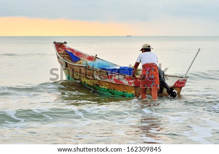 Fishermen ready to go to the sea at the morning. - stock photo