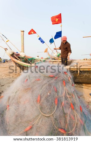 Fishermen removing fish from fishing nets at beaches HAILY, NAMDINH, VIETNAM Feb 21, 2016. Fishing is a traditional craft in Vietnam