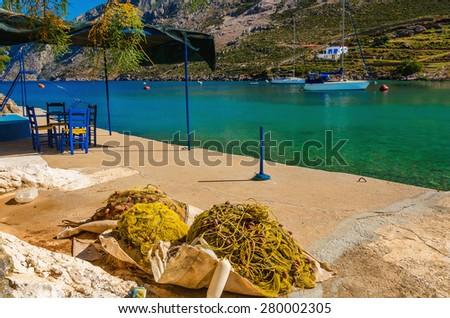Fishermen's nets drying on sun in small port on Greek islands, Greece - stock photo