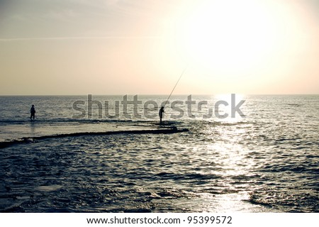 fishermen  silhouette - stock photo