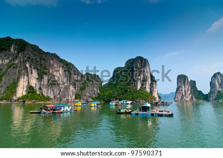 Fishermen village in Halong bay Vietnam - stock photo