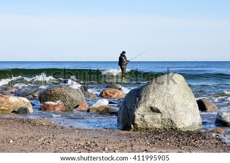 fishermen waiting for a successful catch - stock photo