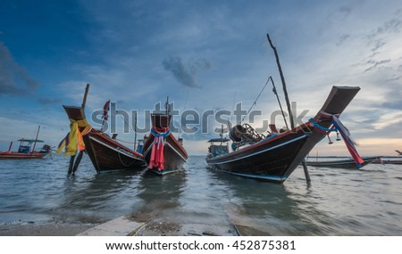 Fishery boats anchor at Gulf of Thailand beach