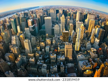 Fisheye aerial panoramic view over upper Manhattan, New York. Sunset of a clean, sunny day with exceptional visibility. - stock photo