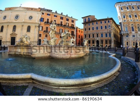 Fisheye image of marble fountain at piazza navona, Rome, capital of italy, typical ancient roman art attracting many tourists - stock photo