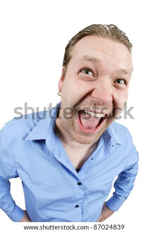 Fisheye photo of a very happy man in his late 20's, over a white background. - stock photo