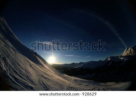 Fisheye shot of a skiing slope in the alps. - stock photo