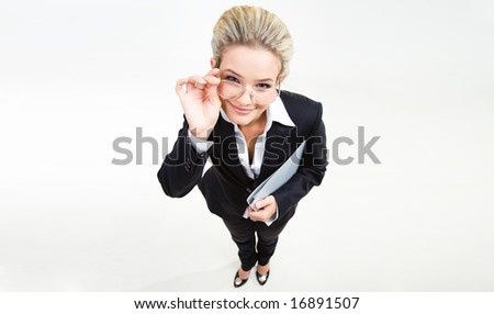Fisheye shot of modern woman looking at camera through glasses with friendly smile - stock photo