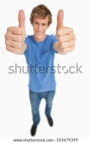 Fisheye view of a male student thumbs-up against white background