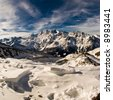 Fisheye view of alps above Saas Fee. View from Hochsaas with ice structures in foreground. - stock photo