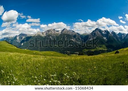 Fisheye view of mountain range above Scuol, Engadin, Switzerland. - stock photo