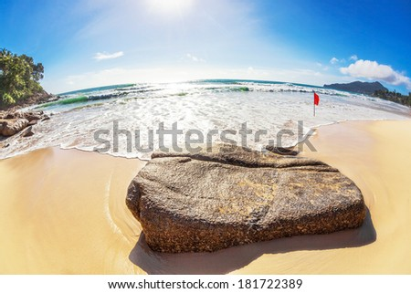 fisheye view on beach and sea with blue sky and sun  - stock photo