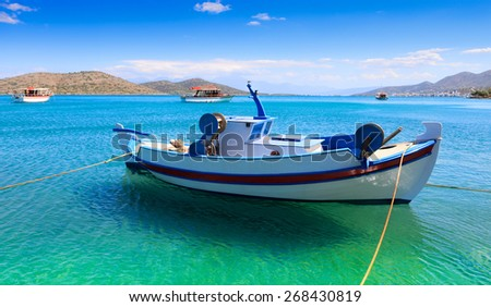 Fishing and pleasure boats off the coast of Crete. Greece, Europe - stock photo