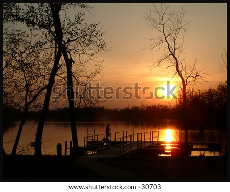Fishing at Sunset - stock photo
