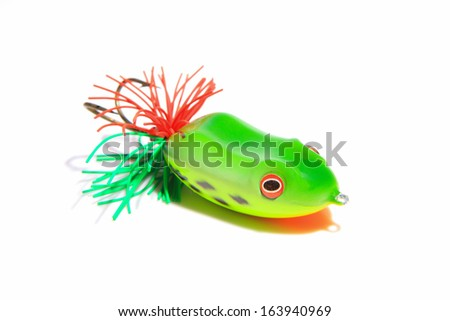 fishing baits  Statues of frogs on white background used in Thailand.  - stock photo