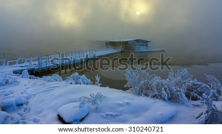 fishing base in water mist winter - stock photo
