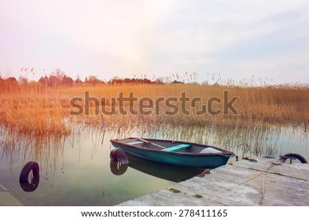 Fishing boat anchored in the docks-Lake Balaton - stock photo