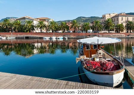 Fishing boat and nets on the river in Bosa in Sardinia - stock photo