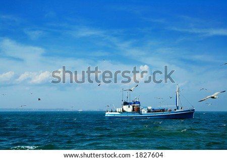 Fishing boat and seagulls - stock photo