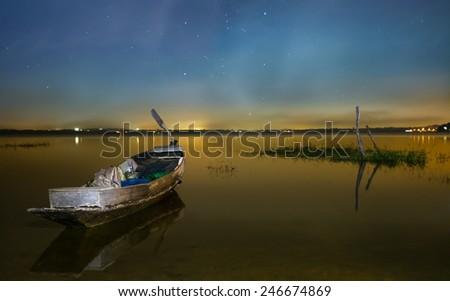 Fishing boat and Sky of night Bang Pra Reservoir, Chonburi, Thailand. - stock photo