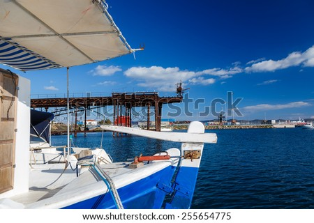 Fishing boat at anchor in Lavrio harbor near Aegean sea, Greece - stock photo